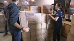 Aid workers prepare emergency aid for war ravaged Syria Stock Footage