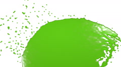 Green fluid stream hits a surface. juice Stock Footage