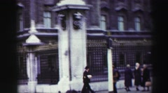 1952: people on a busy street walking past a fence and a building  Stock Footage