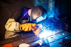 Cutting metal with plasma equipment on plant Stock Photos