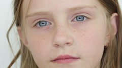 Beautiful young girl indoor, portrait children close up Stock Footage