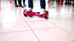 The guy shows to ride Hoverboard Stock Footage