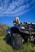 Elegant woman riding ATV Stock Photos