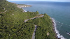 Spectacular coastal highway through coastal rain forest in New Zealand Stock Footage