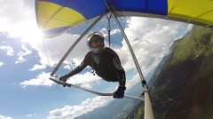 Man maneuvers on a hang glider Stock Footage