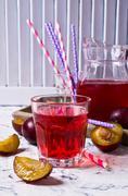 Transparent plum drink Stock Photos