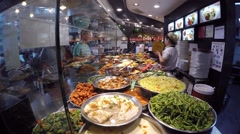 Choice of Prepared Asian Food in Cafe of Food Court Stock Footage