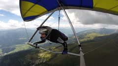 Man flying on a colorful hangglider Stock Footage