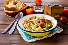 Farfalle pasta with sausage Stock Photos