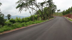 Driving - Driving shot with roof mounted camera on a road in Thailand. Stock Footage