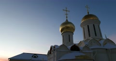 The Golden domes of Holy Trinity Cathedral, winter, dusk Stock Footage
