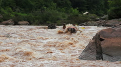 Whitewater rafting team descending raging rapids in Thailand Stock Footage