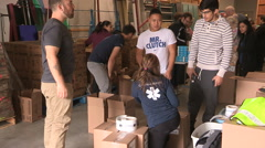 Workers prepare humanitarian aid supplies for middle east Syria Stock Footage