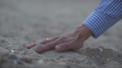 Sand In a handful fall to the ground Stock Footage