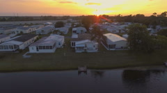 Beautiful Aerial View of Florida Retirement Community at Sunset Stock Footage