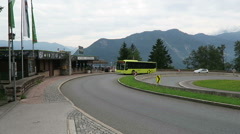 Cars and buses driving along the road next to viewpoint in zillertal valley Stock Footage