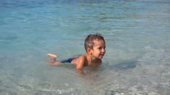 Kid plays with ground sea. Stock Footage
