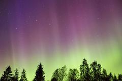 Northern lights (Aurora borealis) in the sky Kuvituskuvat