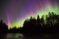 Colorful northern lights (Aurora borealis) in the sky Stock Photos