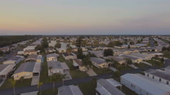 4K Aerial Flying over Florida Retirement Community at Sunset Stock Footage