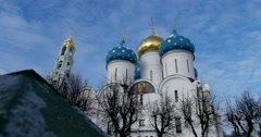 High bell tower, the dome Cathedral, the blue arch of the sky Stock Footage