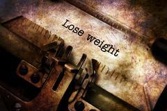Lose weight text on vintage typewriter Piirros