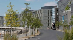 Establishing shot of the relaxed car traffic in a new modern area in Berlin. Stock Footage