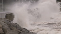 Massive waves pound the shore in hurricane and typhoon force wind event Stock Footage
