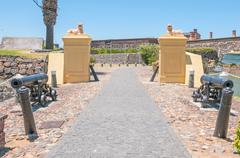 Cannons and lions guarding the Castle of Good Hope Stock Photos