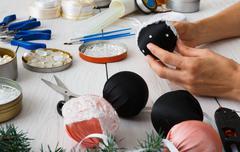 Creative diy craft hobby. Handmade christmas decoration, balls and garland Stock Photos