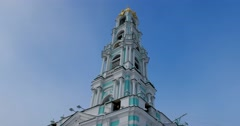 Layered tower shot up high in the blue sky Stock Footage