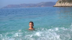 Kid plays with waves Stock Footage