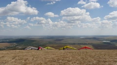 Hang gliders at launch on the hill Stock Footage