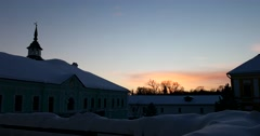 The sunset, the snow-covered roof of the monastic community Stock Footage