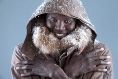 Freezing African male in winter Stock Photos