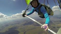 Young woman handle her hang glider Stock Footage