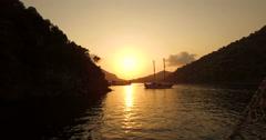 Sun setting over coastal headland Stock Footage