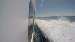 On board view of the hull of boat navigating on choppy sea Stock Footage