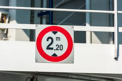 Sign of height restriction at the entrance to the ferryboat Stock Photos