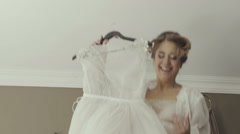Bride jumping on the bed in the rich interior Stock Footage