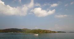 Rounding coastal headland Stock Footage