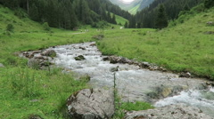Wild stream flowing through Schwarzachtal valley in Tyrol /Austria Stock Footage