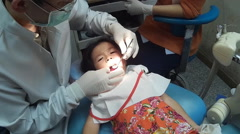 Little girl opening his mouth wide during inspection of oral cavity Stock Footage