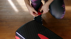 A woman's hands attaching ankle weights. Stock Footage