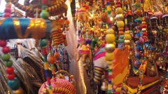 Colorful Handmade Wind Chimes with Ganesha Elephant in Souvenir Store Stock Footage