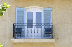 Balcony with balustrade and louvre doors Stock Photos