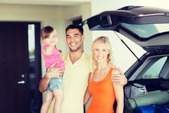 Happy family with hatchback car at home parking Stock Photos