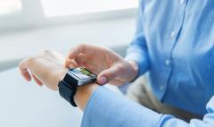 Close up of hands with web page on smart watch Stock Photos