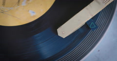 A record player turntable with it's stylus running along a vinyl record Stock Footage