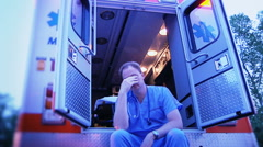 Emergency medical worker in hospital ambulance Stock Footage
